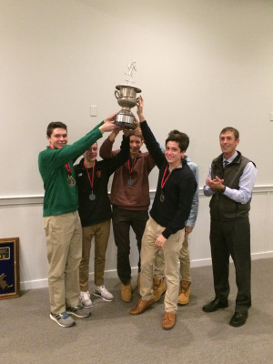 The Wellesley boys (with coach Tim Broe) hoist the 2017 Mahon Cup