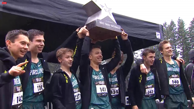 Colton Bogucki (center) almost dropped the trophy before hoisting it in Portland