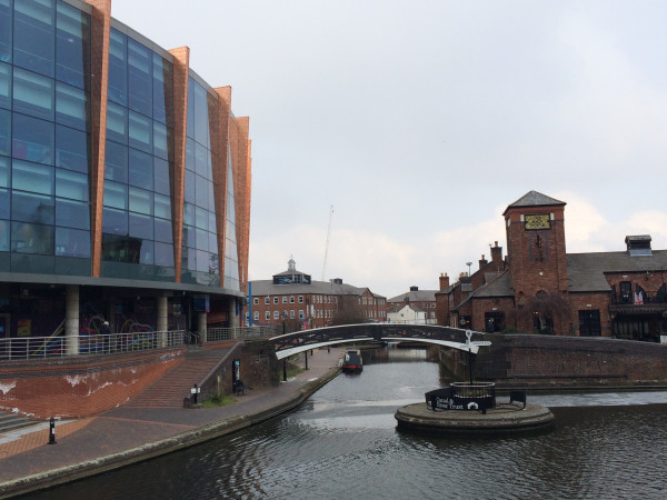 The arena is on the left, the pub on the right across the bridge