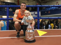 Chris O'Hare with son Ronan after winning the NYRR Wanamaker Mile at the 2018 NYRR Millrose Games (photo by Jane Monti for Race Results Weekly)