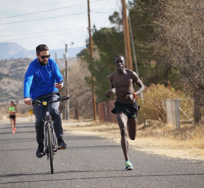 Haas monitoring one of Cheserek's workouts in Flagstaff