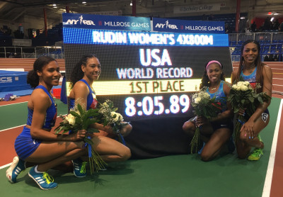 (l to r) Ajee' Wilson, Charlene Lipsey, Chrishuna Williams, and Raevyn Rogers after setting a pending world record for 4 x 800m at the 2018 NYRR Millrose Games (photo by Jane Monti for Race Results Weekly)