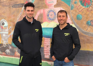 Drew Windle (left) and his coach Danny Mackey of the Brooks Beasts in Downtown Albuquerque on February 15, in advance of the 2018 USATF Indoor Track & Field Championships (photo by David Monti for Race Results Weekly)