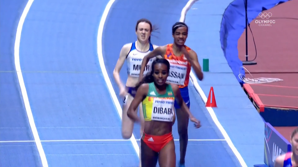 Dibaba drifts wide of lapped runner