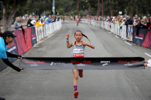 Arielle Avina from Murrieta, Cali. at the young age of 10-years-old dashes to the victory of the 2018 Synchrony Rock 'n' Roll San Diego 5K presented by Brooks. Avina became the youngest female ever to win a Rock 'n' Roll Marathon Series 5K event with a time of 19:21. (Photo credit Sean Haffey/Getty Images for Rock 'n' Roll Marathon Series)
