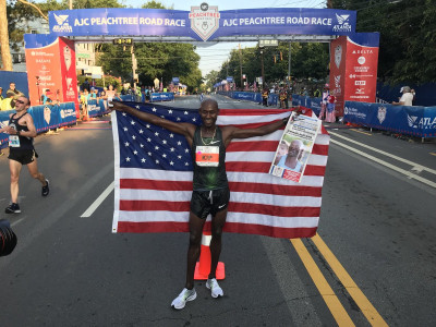 Lagat celebrating his 10k win at Peacthree this year. Photo by USATF; used with permission