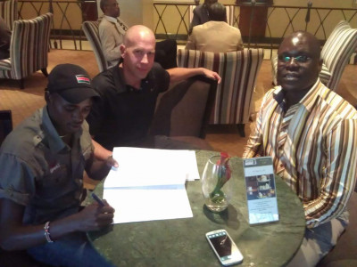 Manangoi signing his contract with Nike's Robert Lotwis & Ouma