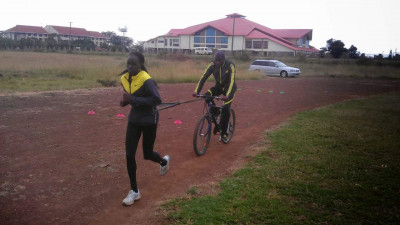 Sometimes Ouma has his athletes use a bicycle instead of the tire (courtesy Bernard Ouma)