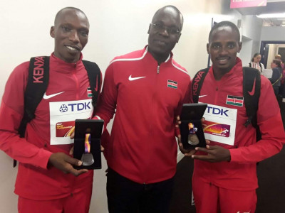 Cheruiyot, Ouma, & Manangoi with the hardware they earned in London
