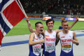 The Ingebrigtsen brothers, Henrik (left), Jakob (center) and Filip celebrate Jakob's 1500m title at the 2018 European Athletics Championships in Berlin (photo by Jane Monti for Race Results Weekly)