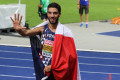 France's Mahiedine Mekhissi-Benabbad holds up five fingers to signify his five continental titles after winning the steeplechase at the 2018 European Athletics Championships in Berlin (photo by Jane Monti for Race Results Weekly)