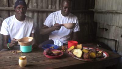 Manangoi and Ouma back in Kisumu enjoying a traditional breakfast of porridge and sweet potato