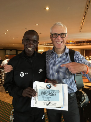 """Kipchoge presented """"Drinks Guy"""" with a signed bib the day after his record run"""