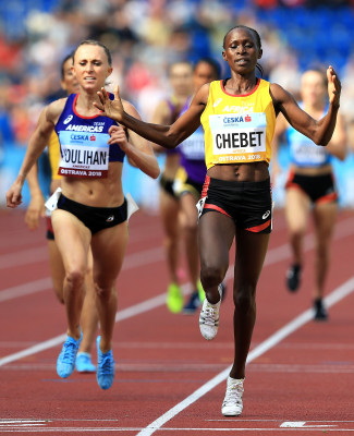 Chebet over Houlihan (Photo by Stephen Pond/Getty Images for IAAF)