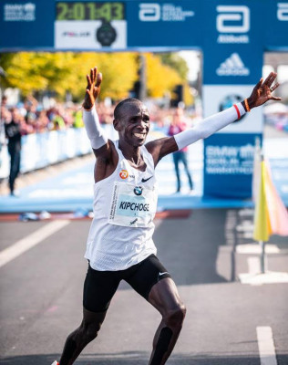Kipchoge on his way to celebrate with Patrick Sang
