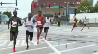 Mo Farah is the guy in red in the back going around the turn