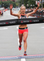 Emily Sisson winning the 2018 Reebok Boston 10-K for Women in 30:30 (photo courtesy of Conventures)