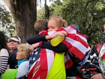 The Hiltons embrace after Nicks win at the 2014 Rock n Roll Savannah Marathon