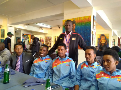 Kiprotich standing with Tadese on left and Eritrean team