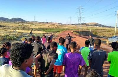 Coach Getaneh explaining the run